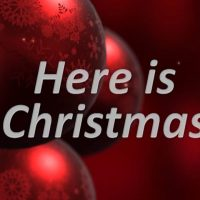 Red Christmas Decor with words: Here is Christmas